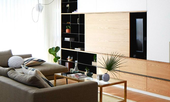 A Modern and Contemporary Home Decor With Unique Features | The unique steel and oak storage piece in the living room brings out the best of the modern design, an incredible creation in Israel's Central District. #interiordesign #homeinteriors #moderndecoration #contemporarydecor #israeldecor