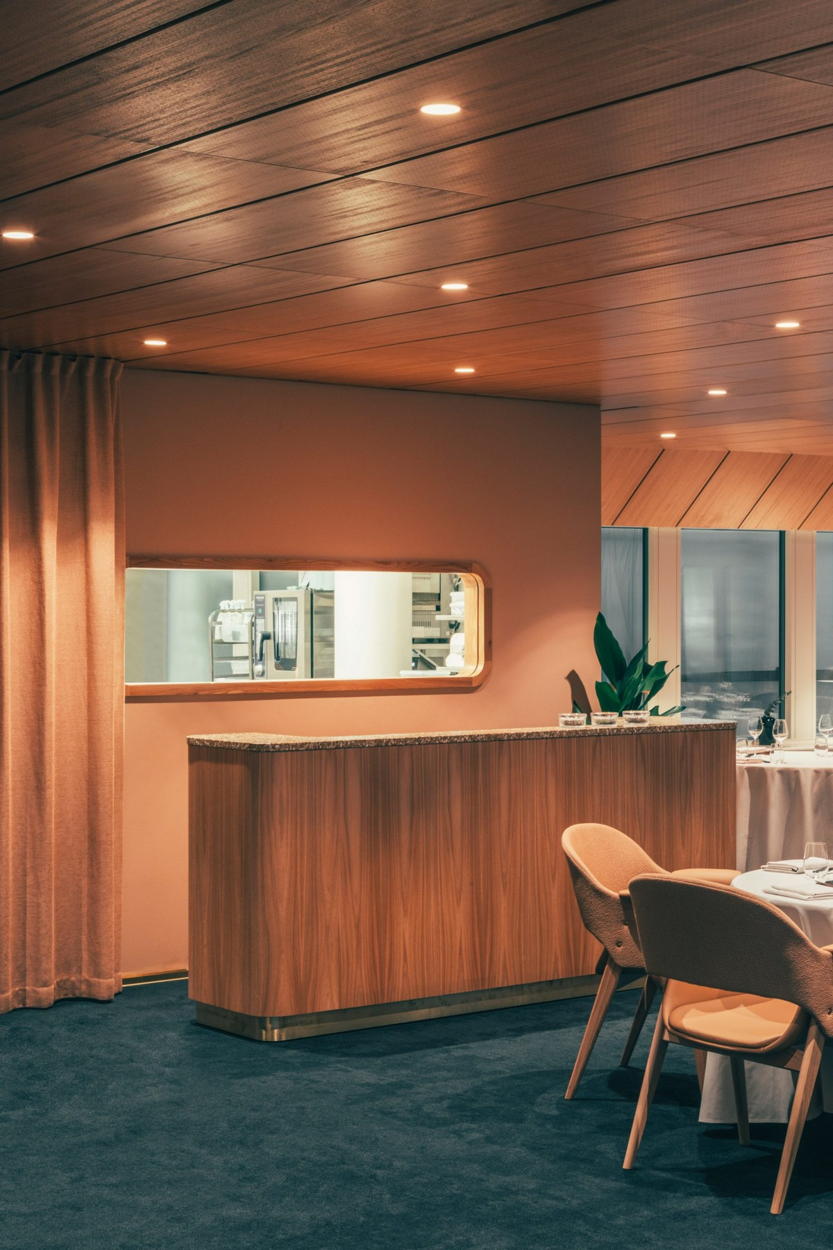 A Restaurant in Helsinki has a New Mid-Century Look | The Note Design Studio, based in Stockholm, renovated a Helsinki restaurant with beautiful pink combinations and a color scheme that truly honors the building's features. #colortrends #interiordesign #centertables #midcentury #midenturydesign