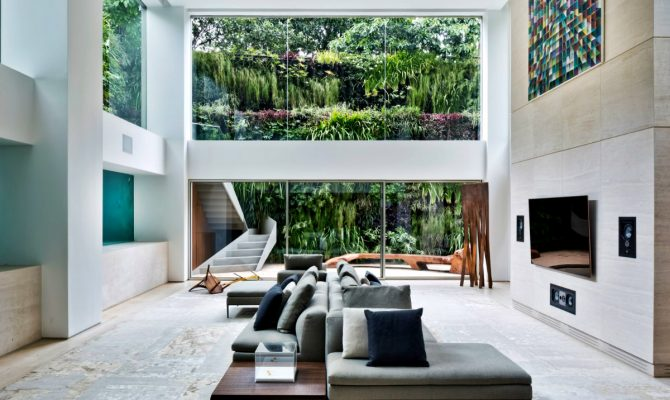 Ever Wished of Having a Pool Inside Your Home? Here's How | In an outstanding residence in São Paulo, Brazil, swimmers can be seen from the room through thick glass panels, like fish in an aquarium. #interiordesign #innovation #insidepool #homedecor