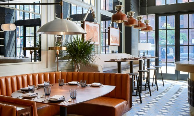 An Old Printing House Turns Into a Mesmerizing Restaurant | The place was transformed into a marvelous place full of mid-century lamps that hang above burnt orange leather booths. #interiordesign #restaurantdesign #restaurantdecor #decorideas #midcenturyideas